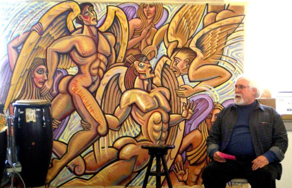 "This photo of me participating in a seminar this year called ""Healing Earth Pain through the Arts,"" shows my 6 x 8 ft acrylic painting, ""Fallen Angels,"" which has been ""in progress"" for 30 years. I may continue developing it until I can no longer do so. There is something comforting about having a very long term project."