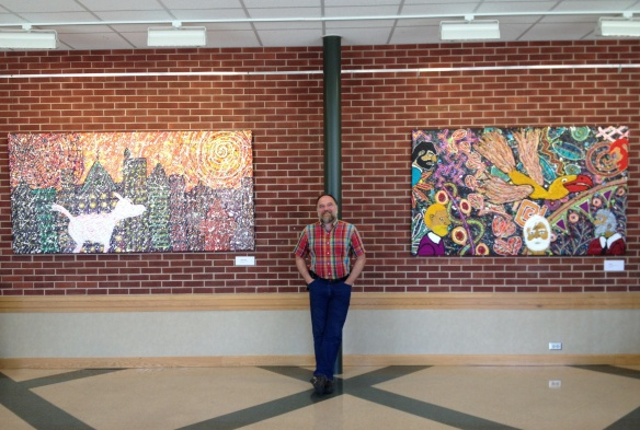 "Outsider Artist, Robert F Allen with two of his most recent 2013 paintings: 4x8 ft ""A Winter Walk,"" and 4x7 ft ""Escape!"" Both acrylic paintings on canvas are among 44 of Robert's large works on display at Manchester University, North Manchester, Indiana, in Link Gallery, Winger Building (across the street from The Union) until Nov 19, 2013."