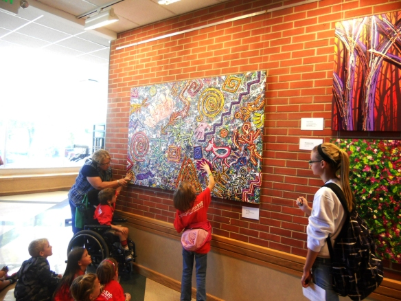 "Visitors of all ages enjoy touching Robert's art. Children especially want to place their hands on the hand prints in the design of ""The Story."""